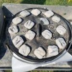 Here I've got the coals on the Dutch oven and we're cooking from all sides.